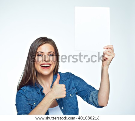 Positive smiling woman holding sign board and show thumb up. Isolated on white background.