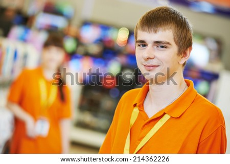 Positive team of shop assistants in supermarket store - stock photo