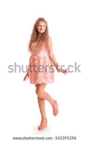 positive teen girl in dress. portrait isolated on white background