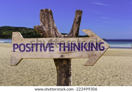 Positive Thinking wooden sign with a beach on background - stock photo