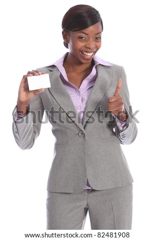 Positive thumbs up sign by beautiful young ethnic african american business woman with a big happy smile, holding a business card in other hand. - stock photo