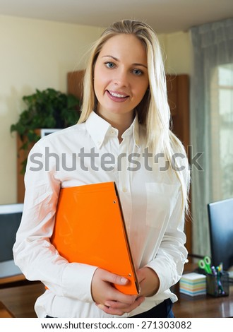 Positive woman in business outfit in home interior