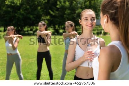 Positive women spending day outdoors - stock photo