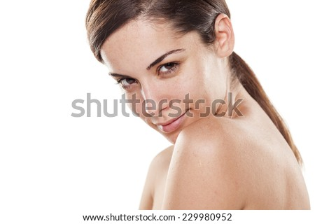 Positive young beautiful woman without make up posing on white background - stock photo