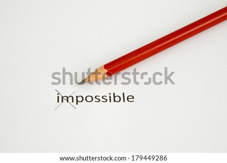Possible concept by using red pencil crossing impossible word