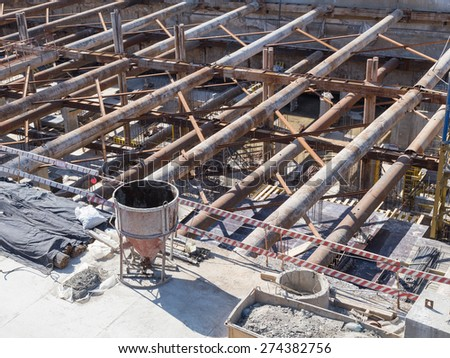 post-and-beam system with metal beams and concrete pillars at a construction site