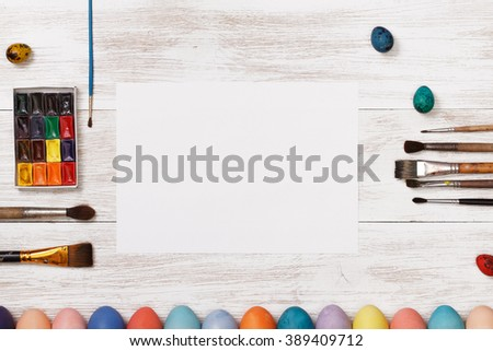 Post blog social media Easter. View from above with copy space. Banner template layout mockup for happy Easter. White wooden table, top view on workplace. Colored eggs at the office Desk. - stock photo