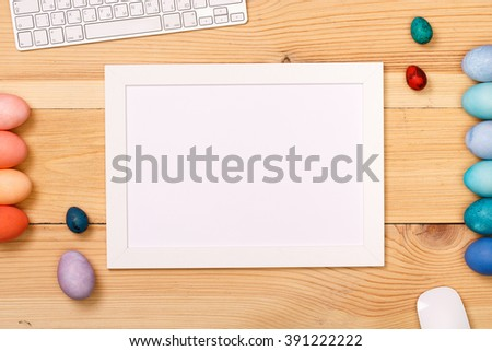 Post blog social media Easter. View from above with copy space. Banner template layout mockup for happy Easter.Wooden table, top view on workplace. Colored eggs at the office Desk. - stock photo