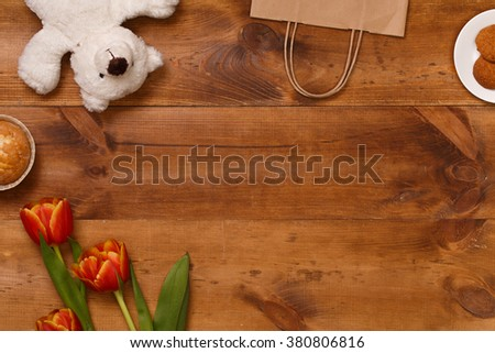 Post blog social media 8 march. View from above with copy space. Banner template layout mockup for woman day. Brown wooden table, top view on workplace. Lilac tulips at the Desk. - stock photo