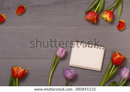 Post blog social media 8 march. View from above with copy space. Banner template layout mockup for woman day. Gray wooden table, top view on workplace. Pink tulips over shabby white wooden table. - stock photo