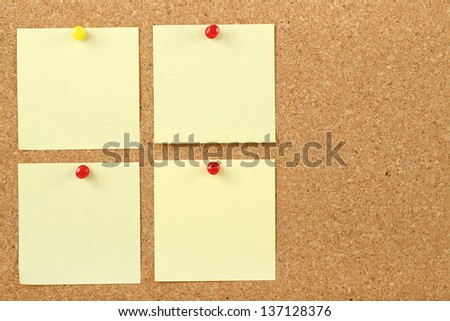 post it notes on corkboard