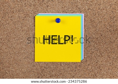 "Post-it notes with word ""Help!"" on cork board (bulletin board)."