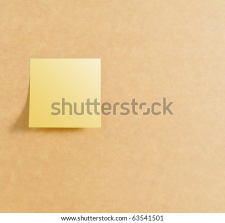Post it on left of brown board texture - stock photo