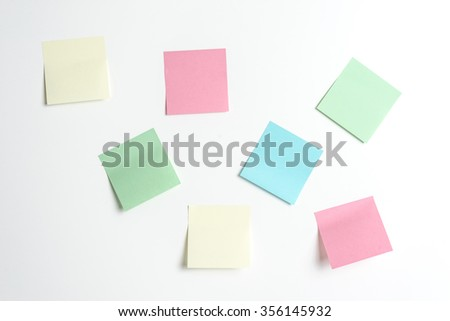post-its on the wall as a reminder - stock photo