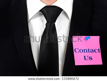 Post with contact word on chest - stock photo