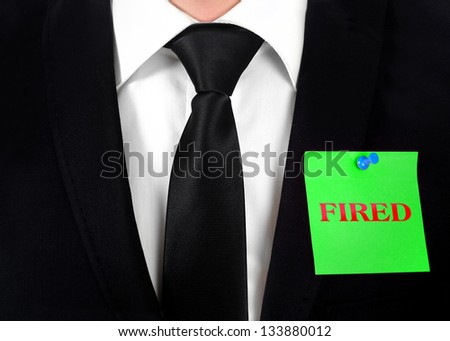 Post with fired word on chest - stock photo