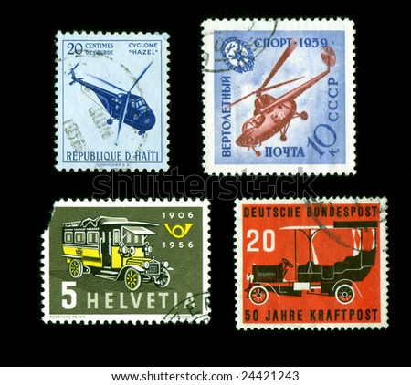 Postage Stamps transportation theme from around the world isolated on black - stock photo