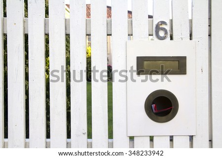Postal box vintage on wooden fence. - stock photo