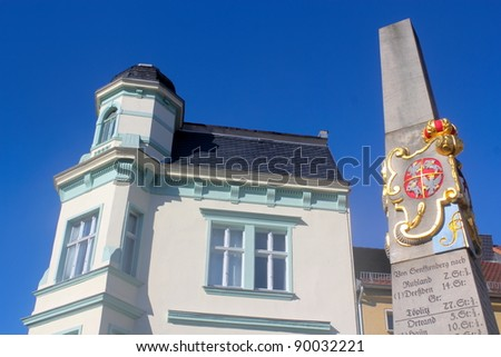 Postal milestone and the old building - stock photo