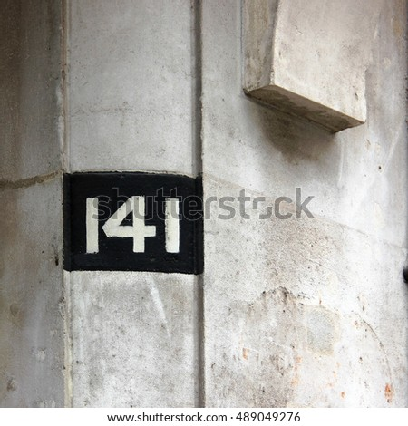 Postal or address numbers on residential or business buildings for indentification