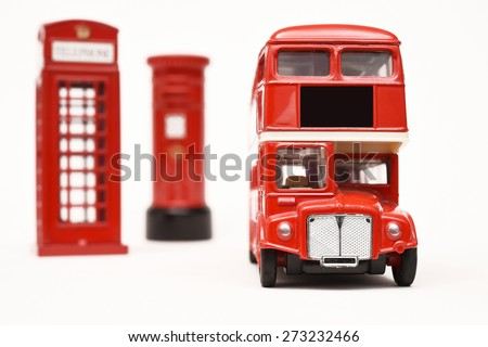Postbox and red telephone box with red bus - stock photo