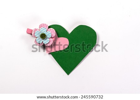 Postcard from the green heart and pink barrettes - stock photo