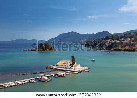 Postcard view of Vlacherna Monastery and Pontikonisi on Corfu, Greece. Probably the most iconic and well known corfiot landmarks.