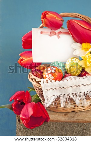 Postcard with a bow and Easter eggs on a background of spring flowers - stock photo