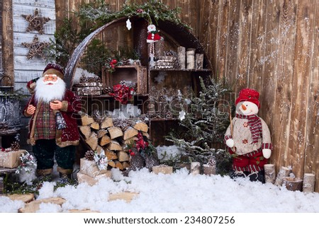 postcard with Santa Claus and snowman in decorative room - stock photo