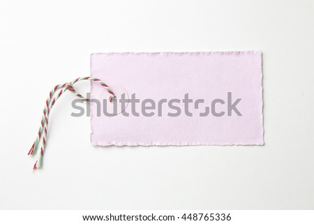 Postcard with splendid and empty tag for your text.pink paper.