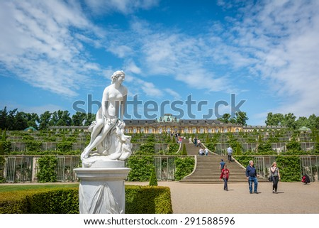 Postdam, Germany: June 2, 2015. Sanssouci Palace  visited by tourists every day. It is  is the former summer palace of Frederick the Great - King of Prussia. Rococo style architecture. - stock photo