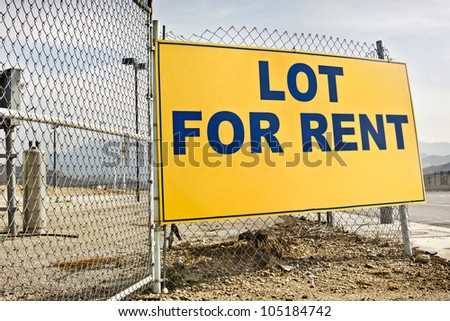 Posted rent sign on a metal fence. - stock photo
