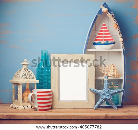 Poster frame mock up template with summer home decor on wooden table - stock photo