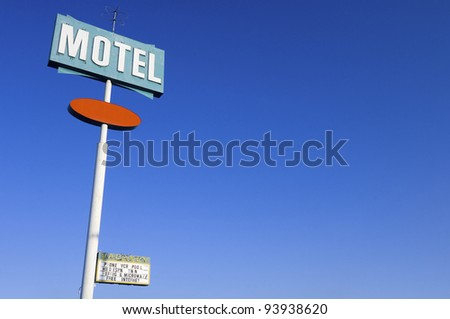 poster green motel with clear and blue sky - stock photo