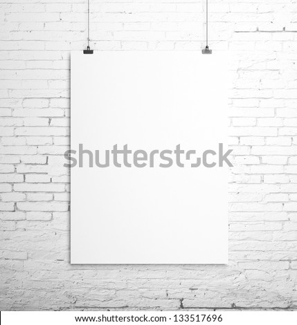 poster hanging on a rope and brick wall - stock photo