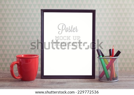 Poster mock up template with coffee cup on wooden table - stock photo