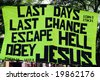 Poster urging people to believe in Jesus and warning about the end of time, held up during a demonstration - stock photo