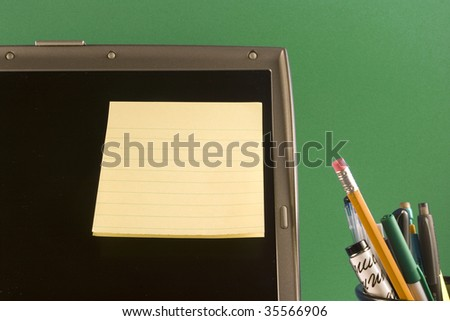Postit on laptop - stock photo