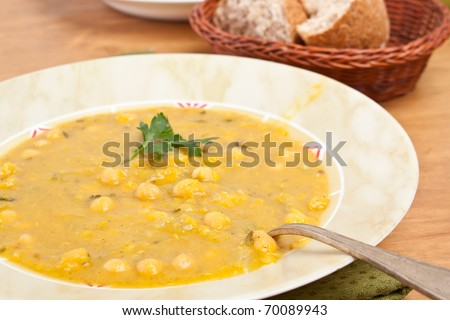 pot of chick-pea and lentil moroccan soup - stock photo
