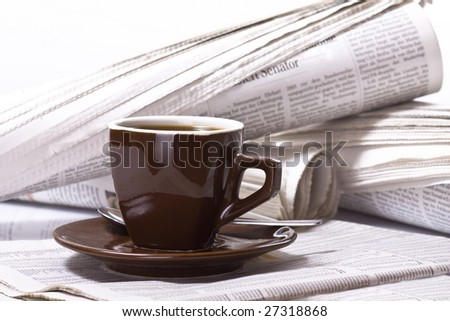 Pot of Coffee on newspaper background, business - stock photo