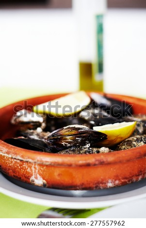 pot of mussels  - stock photo