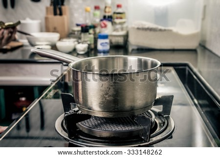 pot on gas stove in the kitchen - stock photo