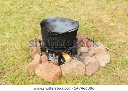 Pot with a magic brew at the stake - stock photo