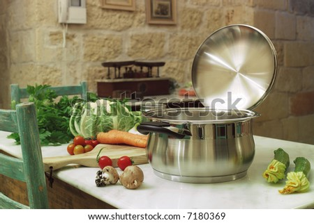 pot with cabbage, mushrooms, carrot, tomatoes on a marble table in a rustic home