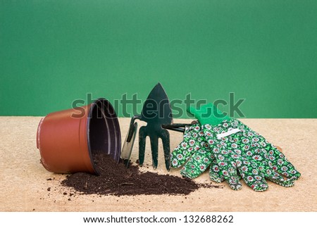 pot with garden tools - stock photo