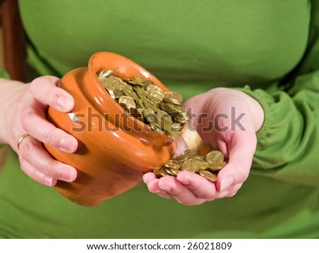 pot with money in hand