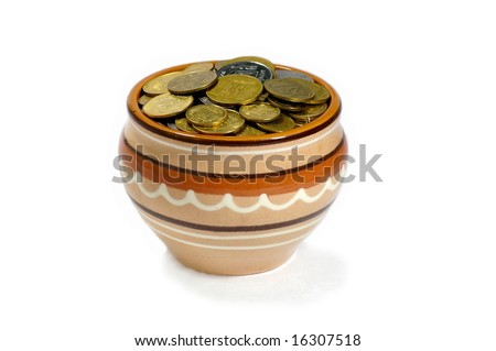 Pot with the coins, the investment of capital and obtaining profit. - stock photo