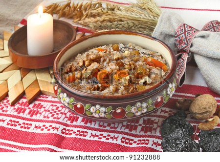 Pot with wheat porridge which is prepared on Christmas Eve Kutya is a traditional food on Christmas Eve. - stock photo