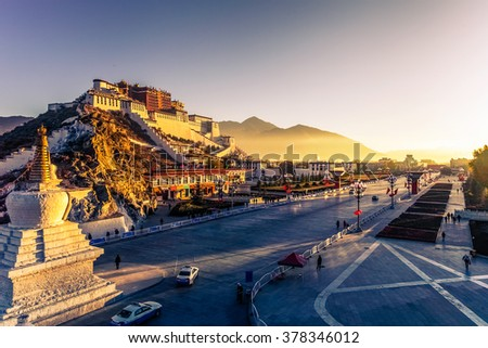 Potala Palace and stupa at dusk in Lhasa, Tibet - stock photo