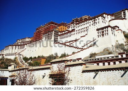 Potala palace with the Potrang Karpo-White Palace to the East and the Potrang Marpo-Red Palace to the west at 3700 ms.high over Marpo Ri-hill overlooking Lhasa town. Tibet A.R.-China. - stock photo